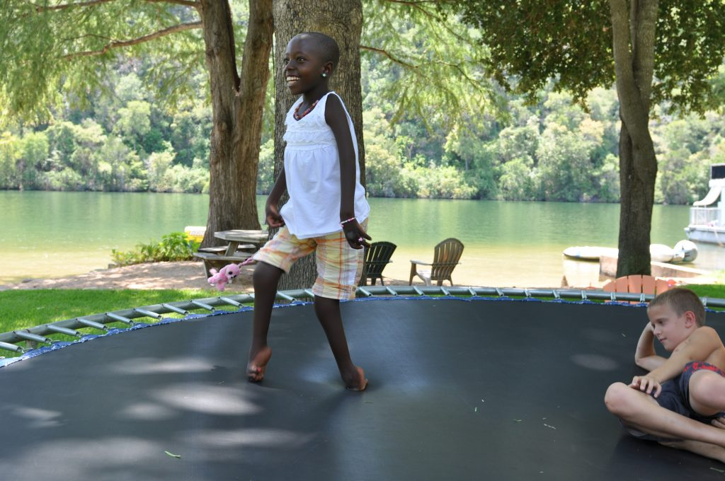 Rebeka loved the trampoline, running around the edges chasing, or being chased.