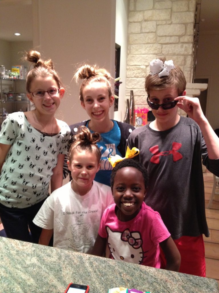 Alayna styled bows out of hair, those without enough hair had to make do with ribbons . . .