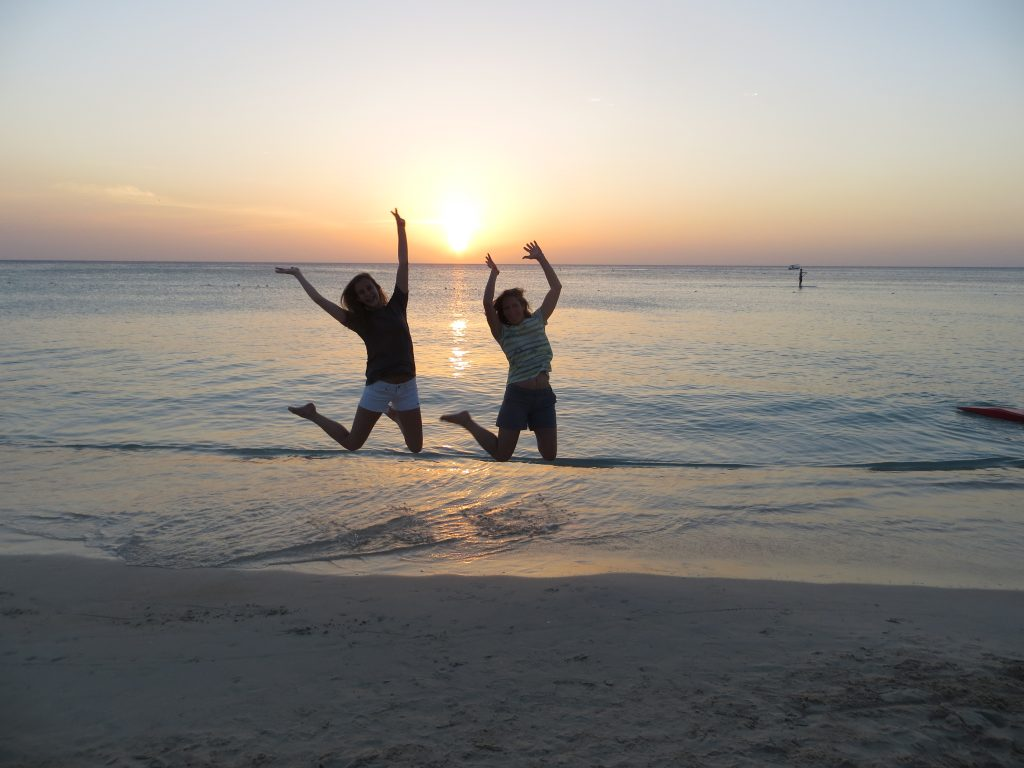Alayna and I participating in the obligatory jumping at sunset picture.