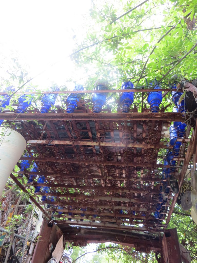 Old mattress springs,  blue bottles and sunshine. A masterpiece.